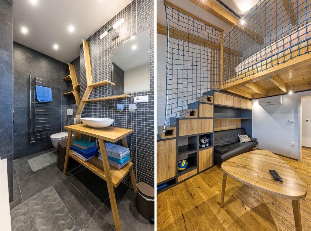 kúpeľňa v odtieňoch sivej s drevenými policami imitujúcimi konáre a interiér s bezpečnostnou sieťou namiesto zábradlia