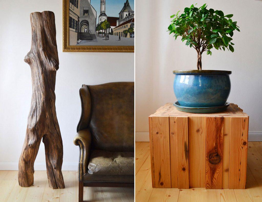 drevená socha a drevený podstavec s keramickým kvetináčom