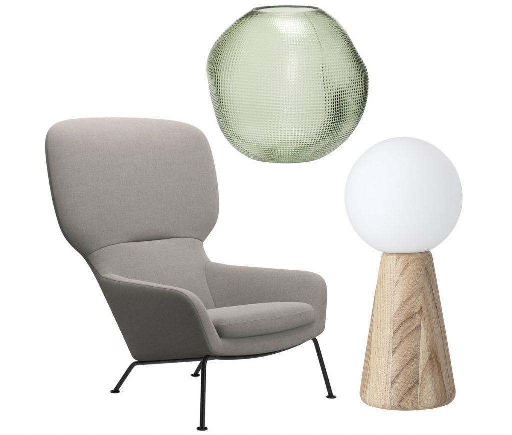nábytok a doplnky hodiace sa k odtieňu farby roka 2020 mätovo sivej: svetlozelené čalúnené kreslo, stolová drevená lampa a sklená zelená váza