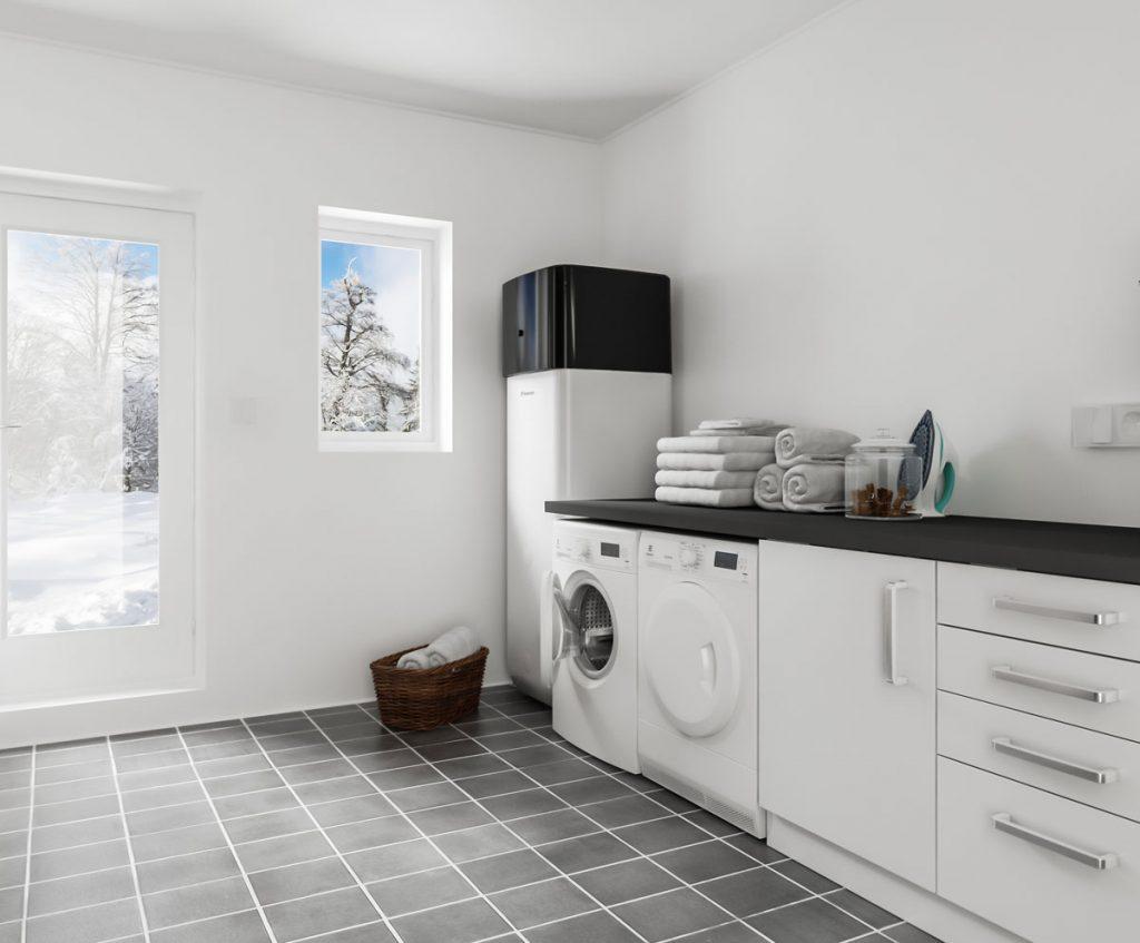 ako ušetriť na dodávke tepla pri kúrení čerpadlom: interiér práčovne s čerpadlom