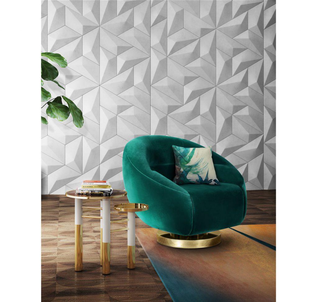 Ako upraviť steny v obývačke: interiér s tapetou s 3D vzorom a zeleným zamatovým otočným kreslom.