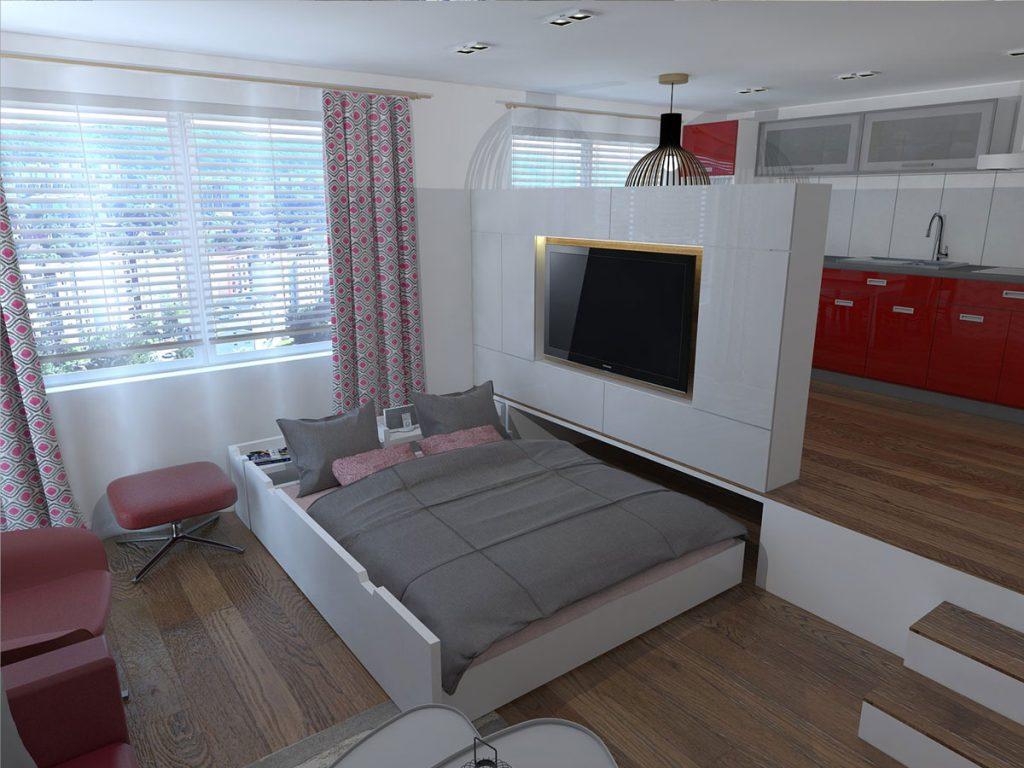 Obývačka riešená aj ako spálňa formou postele, ktorá sa zasúva pod vyvýšenú podlahu kuchyne.