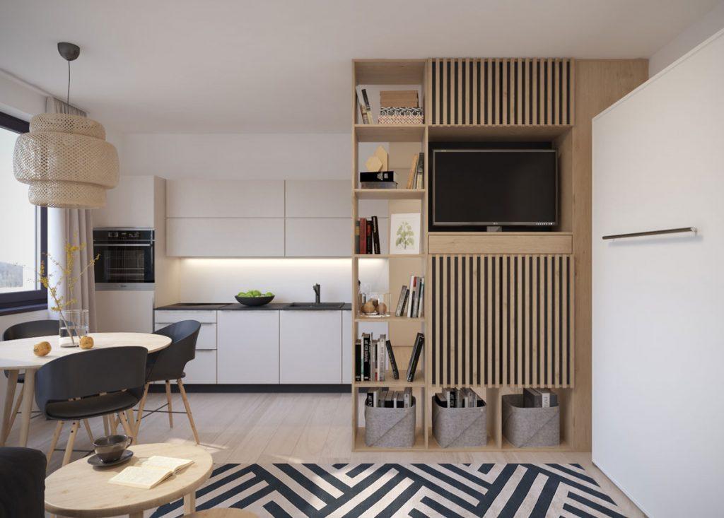 Kuchyňa spojená s obývačkou a spálňou v jednom, z časti oddelená policovou TV stenou, sklápacia posteľ v obývačke je ukrytá v skrini.