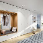 Moderná biela skriňa s otvoreným výklenkom na odkladanie kabátov a sedenie.