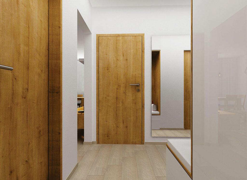 Presvetlenie úzkej predsiene pomocou bielej úložnej skrine s otvoreným priestorom na sedenie a zrkadlom.