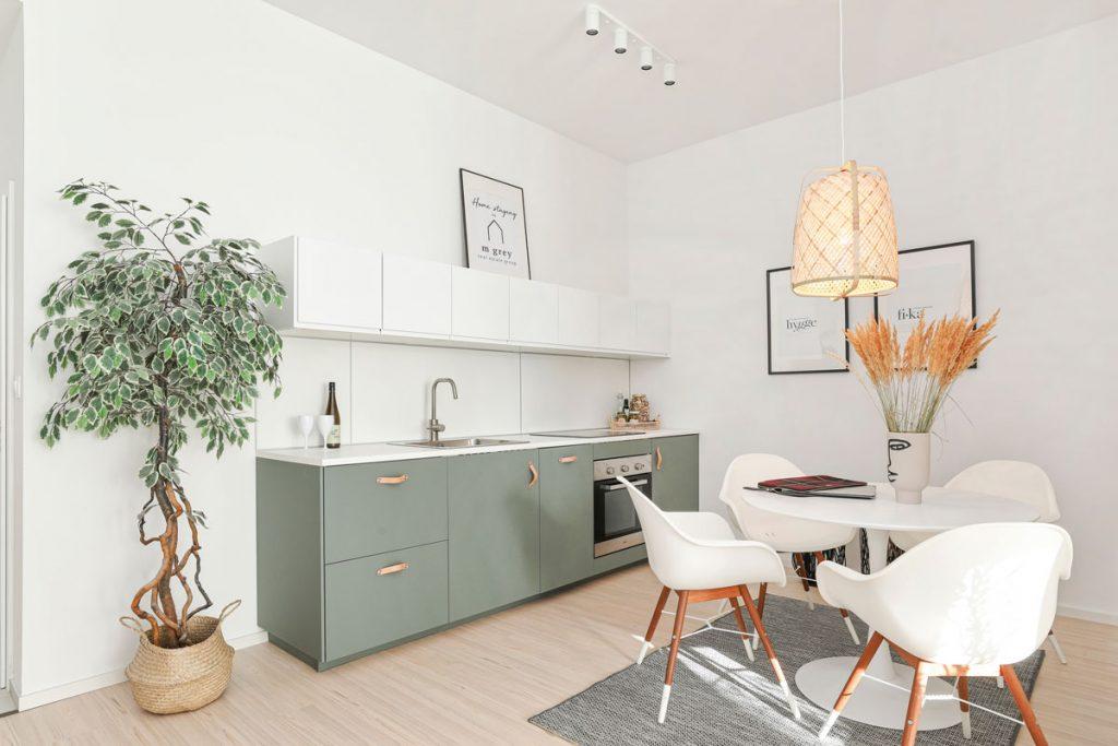 Kuchynská minimalistická linka v olivovo zelenej farbe a okrúhly biely jedálenský stôl s bielymi stoličkami