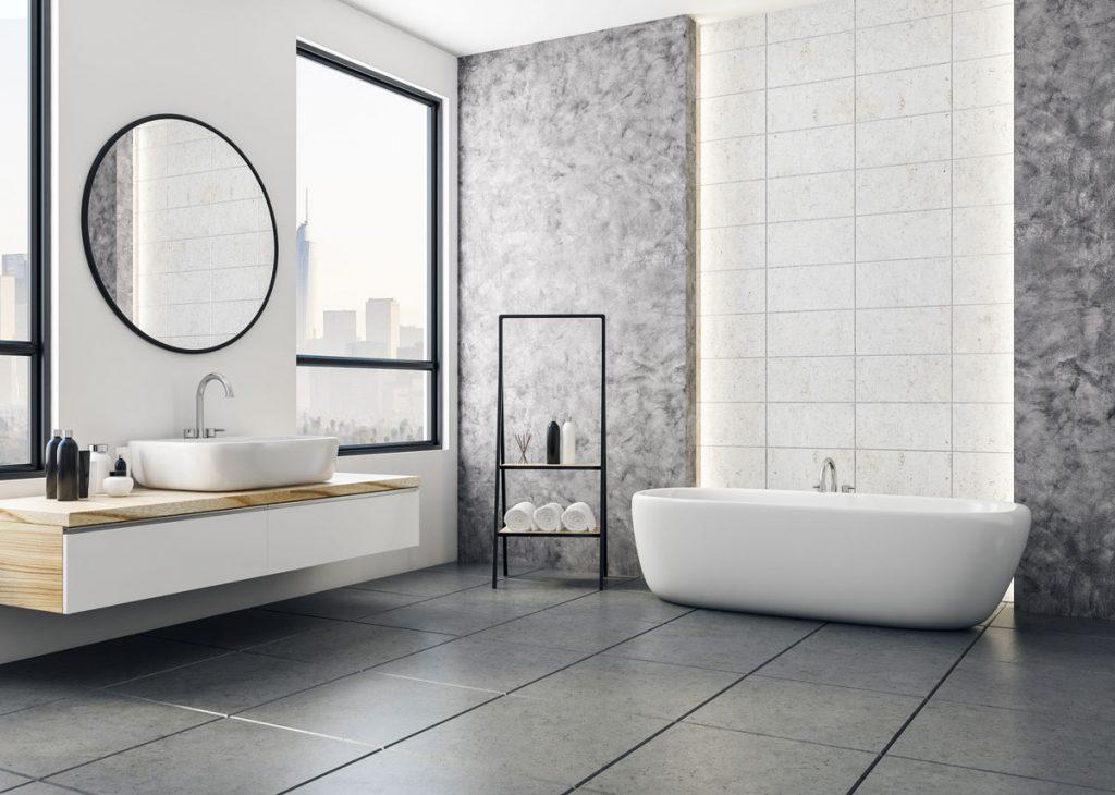 Akú podlahu zvoliť do kúpeľne: moderná kúpeľňa s veľkoformátovou šedou dlažbou