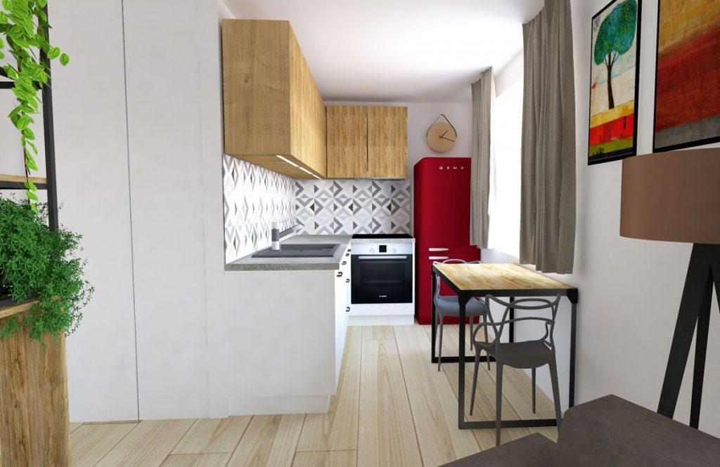 Úzky priestor s rohovou kuchynskou linkou so vstavanými spotrebičmi a jedálenským stolom.