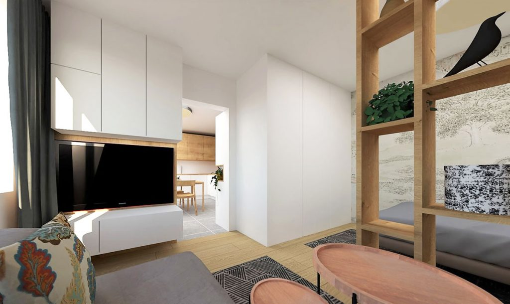 Pohľad z obývačky do otvoreného prechodu vedúceho do kuchyne.