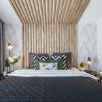 spálňa s dreveným obkladom z líšt na zadnej stene a strope a tapetou so vzorom listov
