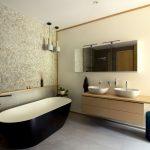 kúpeľňa s dizajnovou čiernou vaňou, kamienkovým obkladom, kozmetickým stolíkom a betónovými svietidlami